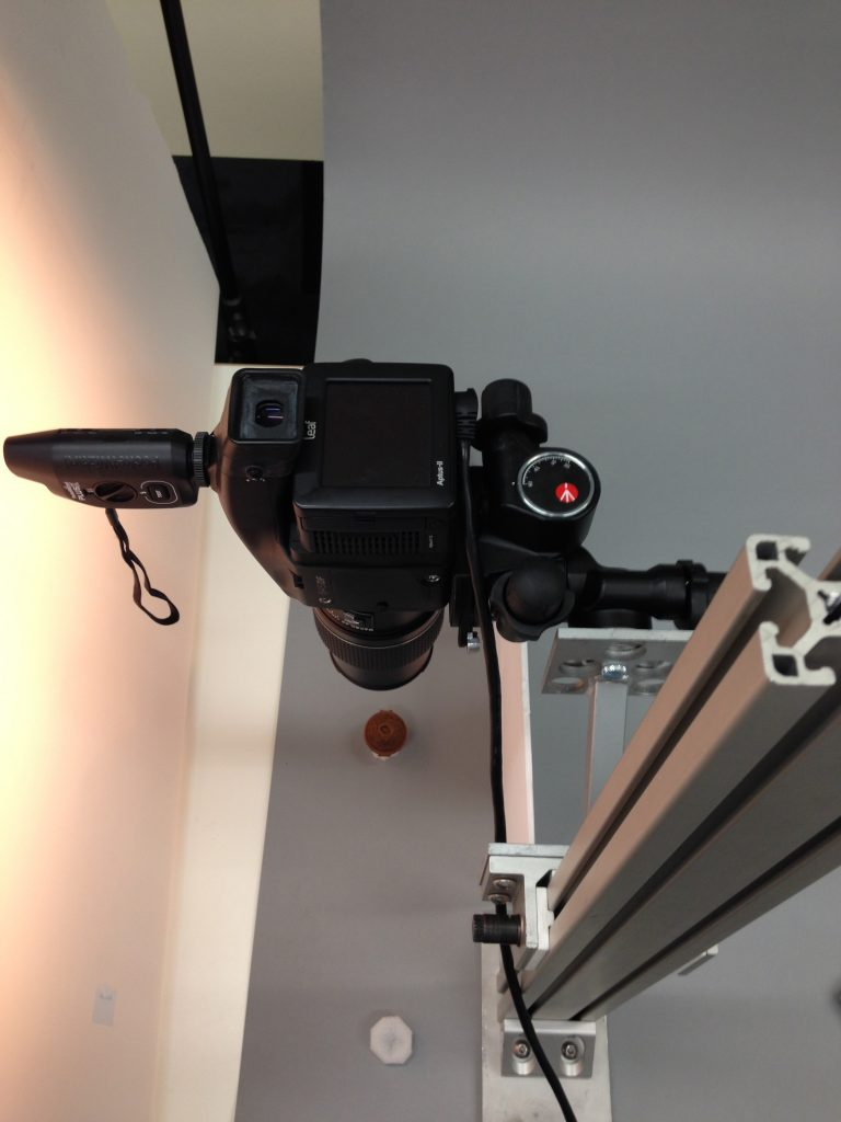 Camera mounted on custom rig, shooting top down on prayer bead